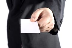 Giving a blank business card. A business man handing out a blank card stock photos