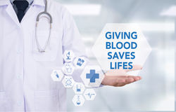 GIVING BLOOD SAVES LIFES Royalty Free Stock Photos