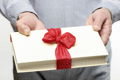 Giving book as a present Stock Photos