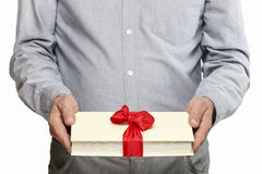 Giving book as a present Stock Photo
