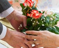 Giving a bouquet of roses Royalty Free Stock Image