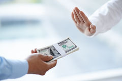 Giving bribe. Businessman refuses to take bribe: corruptio concept stock images