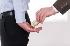 Giving a bribe. Royalty Free Stock Photography