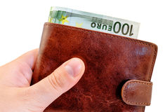 Giving bribe from dark red leather wallet with one hundred Euro isolated Stock Photos