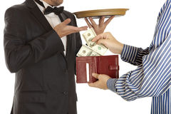 Giving a bribe. Dollar banknotes. White background Royalty Free Stock Images