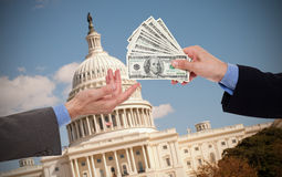 Giving a bribe. Hands of businessmen or politicians royalty free stock image