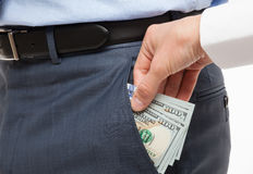 Giving a bribe into a pocket Royalty Free Stock Photo