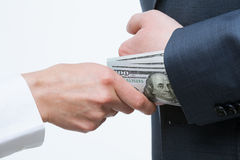 Giving a bribe into a sleeve Royalty Free Stock Image
