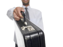Giving briefcase Stock Photos