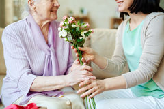 Giving bunch of fresh roses Royalty Free Stock Photos