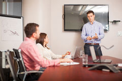Giving a business presentation Stock Image