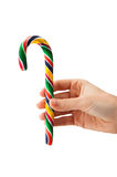 Giving a candy cane Royalty Free Stock Photo