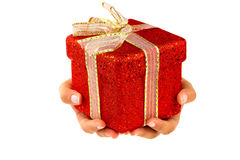 Giving a christmas gift Royalty Free Stock Images