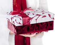 Giving a Christmas present Stock Images