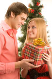 Giving christmas present Stock Photo