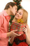 Giving christmas present Royalty Free Stock Photo