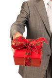 Giving Christmas present Royalty Free Stock Images