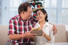 Giving Christmas present Stock Photography