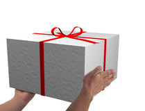 Giving a christmas white gift. In white Stock Images