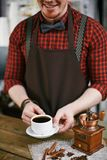 Giving coffee Stock Photography