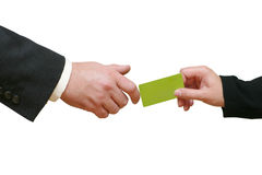 Giving Credit Card. Women's hand giving a credit card to a man's hand. The card is blank so you can easily add your text on it. I will be very happy if you let