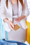 Giving credit card Stock Image