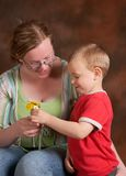 Giving daisies. Four year old son giving daisies to his mother on mother's day Stock Photo