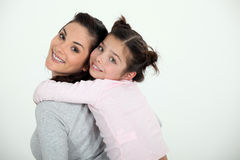 Giving daughter a piggy back Stock Photography
