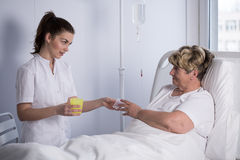 Giving drugs to patient Royalty Free Stock Image