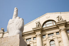 Giving the finger to finance Stock Photo