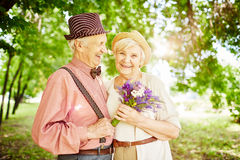 Giving flowers to valentine Stock Image