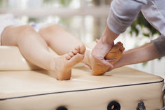 Giving a foot rub at a spa Royalty Free Stock Photo