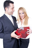 Giving a gift. A man is giving a gift to his partner and making her a surprise Stock Photography