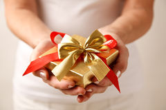 Giving a gift Royalty Free Stock Image