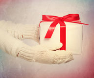 Giving a gift with a big red bow Royalty Free Stock Photo
