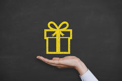 Giving a gift. On Blackboard Background on working conceptual Concept Stock Photos