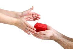 Giving a gift with both hands Royalty Free Stock Images