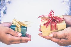 Giving gift box in with hands On special days for special person and copy space background.  royalty free stock photography