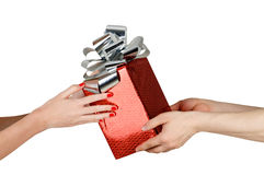 Giving gift from hand to hand Stock Images