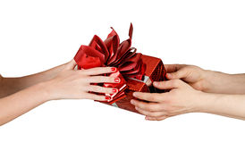 Giving gift from hand to hand Royalty Free Stock Image