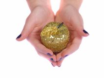 Giving gold apple Stock Photos