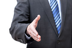 Giving hand. Man in suit giving hand for greeting, isolated Royalty Free Stock Image