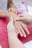 Giving a hand massage Stock Photography