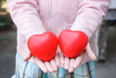 Giving heart. Cuople heart on child hand Royalty Free Stock Photo
