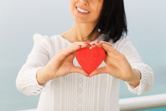 Giving Heart. Female presenting a red heart Stock Photos