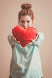 Giving a Heart. Retro colors Stock Images