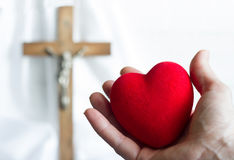 Giving heart to Jesus abstract concept with easter cross Royalty Free Stock Photo