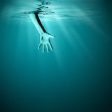 Giving helping hand in sea underwater Royalty Free Stock Photo