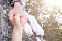 Giving a helping hand. Snow in the mountains royalty free stock photos