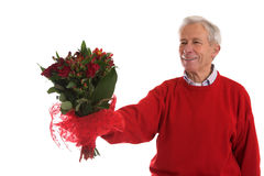 Giving her flowers stock photography